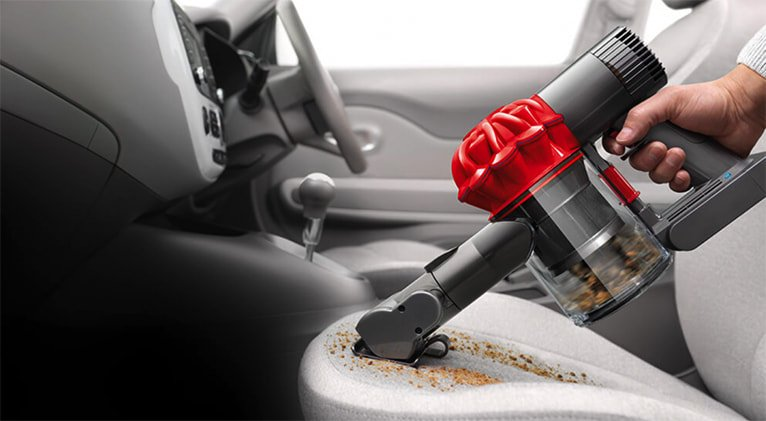 cleaning car with vacuum cleaner